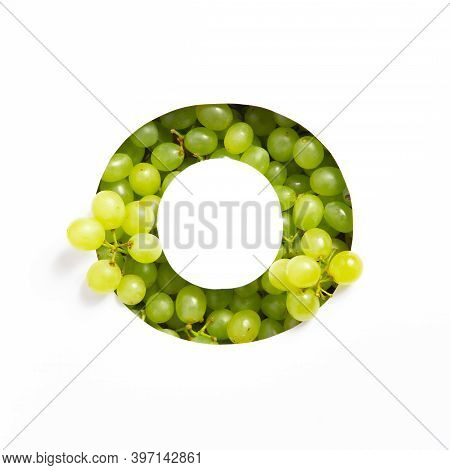 Letter O Of English Alphabet Of Fresh Grape And Cut Paper Isolated On White. Typeface Of Green Berri