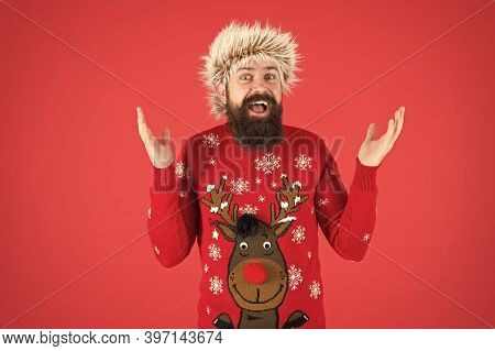 Bearded Hipster Wear Knitted Sweater And Furry Hat. Barbershop Services. Man With Long Beard And Mus