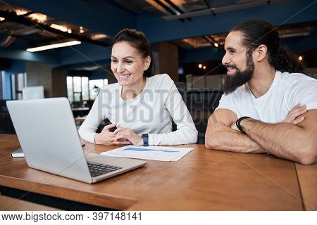 People Working Together At Meeting In Office