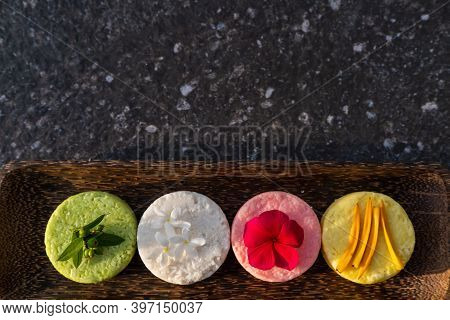 Variety Of Different Natural Eco Friendly Colorful Solid Shampoo Bars, Conditioner Or Soaps On Stone