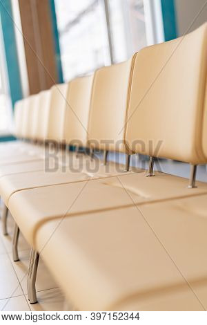 Lobby Or Waiting Hall In An Airport. Raw With Leather Light Chairs. Selective Focus.