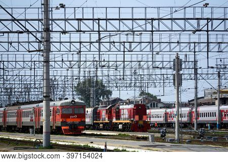 Perm, Russia - August 07, 2020: Passenger Trains On The Tracks Near The Platforms Of The Railway Sta