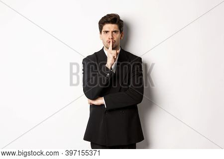Portrait Of Angry Boss In Suit Shushing At You, Telling To Be Quiet, Showing Taboo Hush Sign And Fro