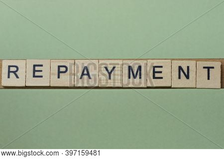 Gray Word Repayment Made Of Wooden Square Letters On Green Background