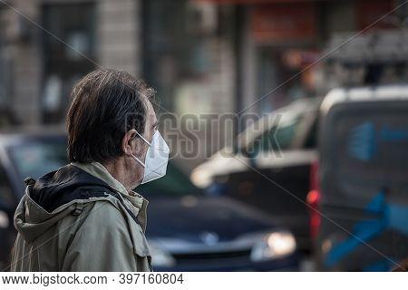 Belgrade, Serbia - November 7, 2020: Old Man Man Walking And Looking At A Street Traffic On A Boulev