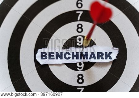Business And Finance Concept. A Piece Of Paper With The Text Is Nailed To The Target With A Dart - B