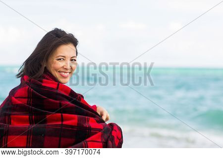 Portrait Of An Asian Woman Wrapped In A Blanket.