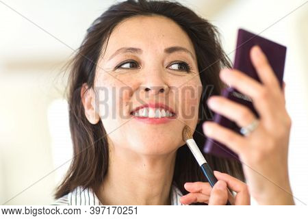 Portrait Of A Asian Woman Applying Make Up.