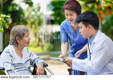 Doctor Checking Lung Of Elderly Woman During Homecare Medical