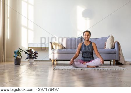 African-american Woman Practicing Yoga At Home. Lotus Position. Calmness.