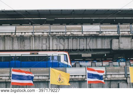 Bangkok, Thailand - Nov 30, 2020: Thai And Royal Flags Decorated Near Siam Square Under Bts Train Li