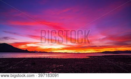 Landscape Long Exposure Of Colorful Color Majestic Clouds In The Sky Sunset Or Sunrise Over Sea With