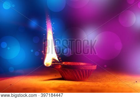 Happy Diwali - Colorful Clay Diya Lamps Lit During Diwali Celebration With Copy Space, Indian Festiv