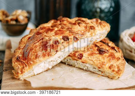 Close-up Of A Traditional Greek Pie Made From Handmade Puff Pastry And Filled With Goats Cheese And