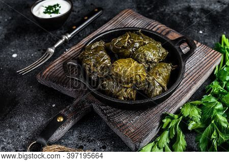 Dolma Stuffed Grape Leaves With Rice And Meat. Black Background. Top View