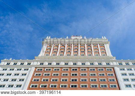 Madrid, Spain - October 18, 2020: Low Angle View Of Riu Plaza Espana Hotel Skyscraper On Blue Sky