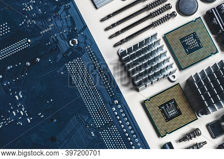 Top View Of Computer Parts With Cpu, Fan Cooler, Battery, Capacitors, Radiator, Chip, Screwdrivers O
