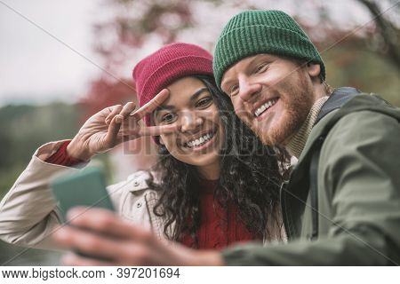 Happy Couple Taking Pictures With A Smartphone