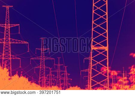 Infrared View Of High Voltage Tower. Industrial High Voltage Lines.
