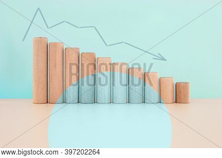 Wood Block Down Graph With Curve Arrow, Risk Management Business Financial And Managing Investment P