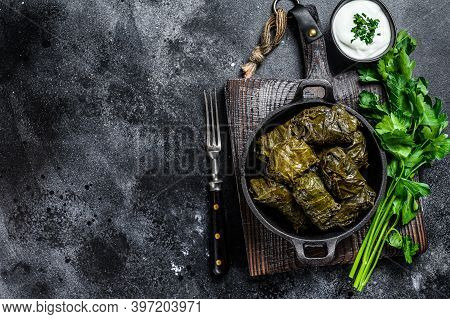 Dolma Stuffed Grape Leaves With Rice And Meat. Black Background. Top View. Copy Space