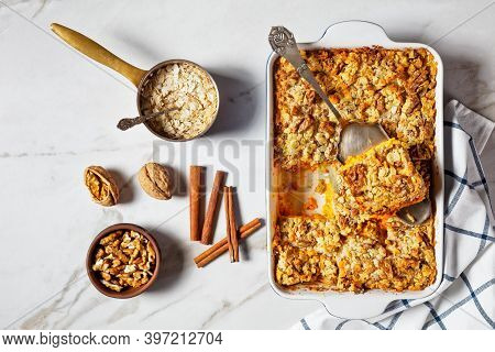 Pumpkin Dump Cake With Traditional Pumpkin Pie Spices: Cinnamon, Clove, Nutmeg With Walnuts And Roll