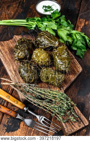 Dolma Traditional Caucasian, Turkish And Greek Cuisine. Dark Wooden Background. Top View