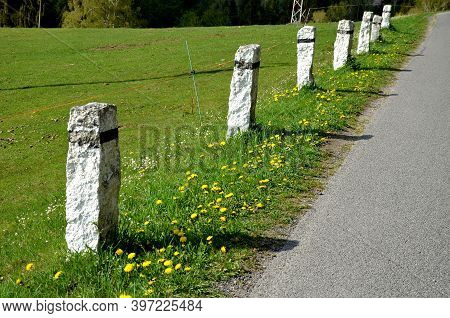 Granite Stone Bollards Old Line The Mountain Road At The Moat On The Edge Of The White Curb With A B
