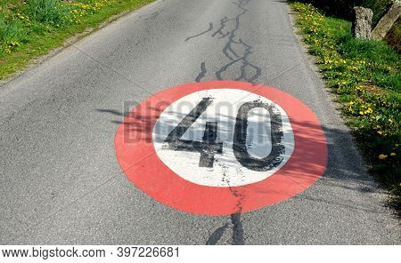 Speed Limit Sign Horizontal Markings On Asphalt Red And White Circle 40 Km Overturned Granite Bollar