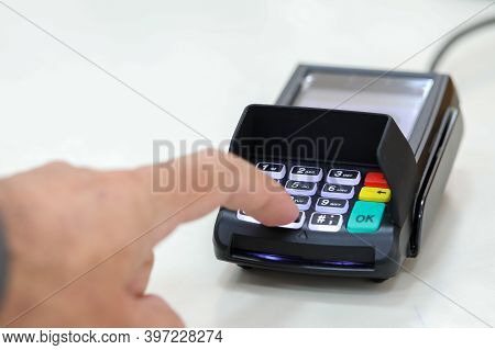 Finger Clicks On A Transaction Confirmation At A Credit Card Payment Terminal.
