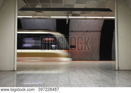 Motin Blured Metro Moving In A Station