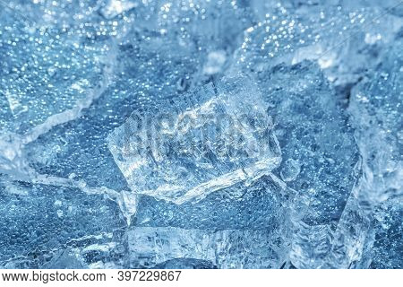 Cracked Ice. Frozen Water, Sea. Frosty Winter Texture. Macro Photography. Sharp Focus On The Front P