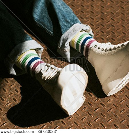 White high top sneakers on model casual style