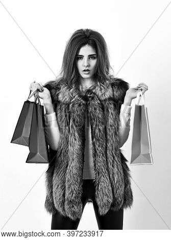 Fashionista Buy Fashionable Clothes In Shop. Girl Makeup Face Long Hairstyle Wear Fur Vest White Bac