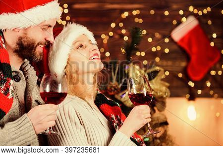 Idyllic Date. Man Woman Santa Claus Hats Cheerful Celebrating New Year. Celebrating Winter Holiday.