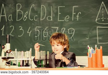 Basic Knowledge Primary School Education. Educational Experiment. Boy Microscope And Test Tubes Scho