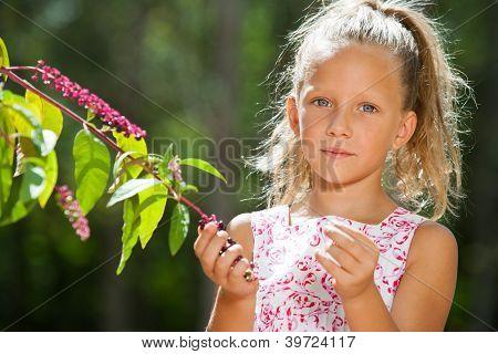 Cute Girl Outdoors Picking Berries.