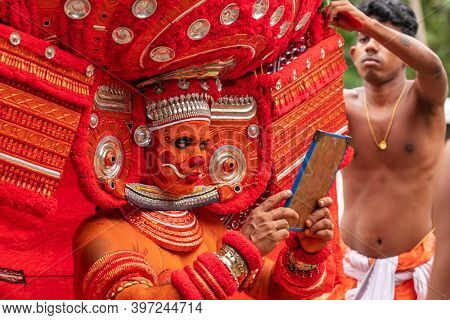 Payyanur, India - December 3, 2019: Theyyam artist perform during temple festival in Payyanur, Kerala, India. Theyyam is a popular ritual form of worship in Kerala, India