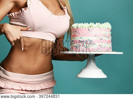 Hands Of Sexy Pretty Fitness Slim Woman In Pink Bra Holding Birthday Cake With Cream And Pointing At