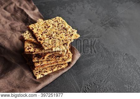 Multigrain Crunchy Crispbread On A Dark Concrete Background.