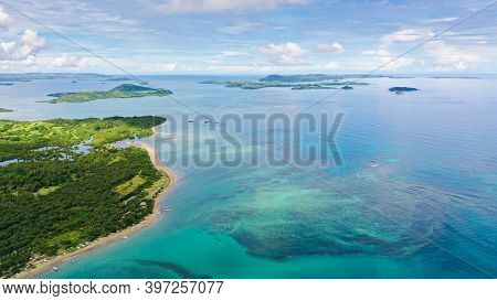 Malay Archipelago With Reefs And Islands. Seascape With Islands In The Early Morning, Aerial Drone.