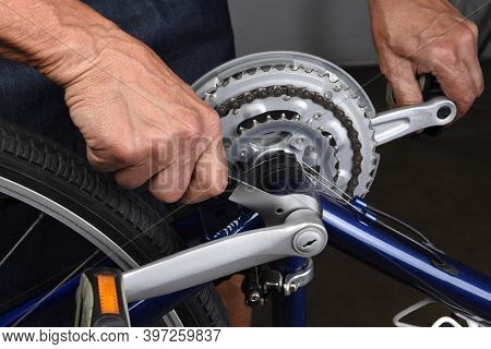 Bicycle Repair. Closeup of a mechanic using a wrench to tighten the crank on a bicycle.