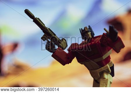 NOV 25 2020: Recreation of a scene from The Transformers with Optimus Prime ready to battle Decepticons - Hasbro  R.E.D. Robot Enhanced Design action figure