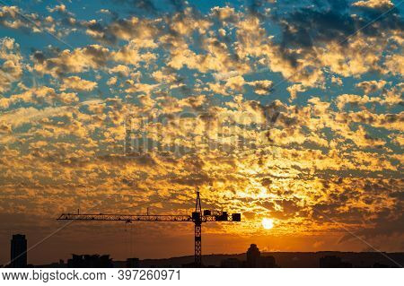 Cranes In The Foreground And Colorful Altocumulus Clouds In The Background In Sunset Time. Beautiful