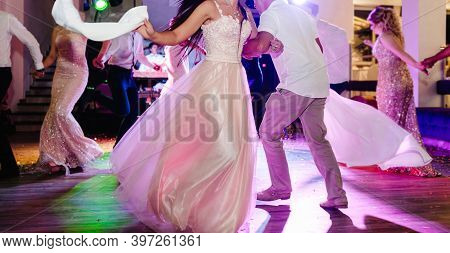 Couple Dancing. First Wedding Dance Of Newlywed. Bride And Groom Dancing In Restaurant.