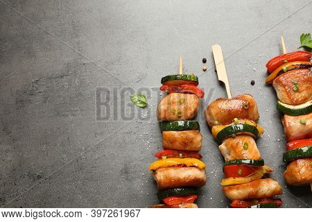 Delicious Chicken Shish Kebabs With Vegetables And Herbs On Grey Table, Flat Lay. Space For Text