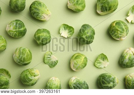 Fresh Brussels Sprouts On Green Background, Flat Lay