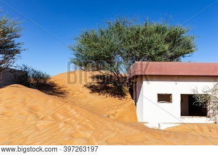 Abandoned Building Buried In Sand In Al Madam Ghost Village In Sharjah, United Arab Emirates, With W
