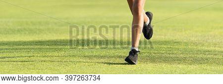 Running Children Detail On Sport Shoes Running Along Green Grass