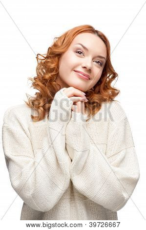 young dreamy caucasian woman in winter clothing